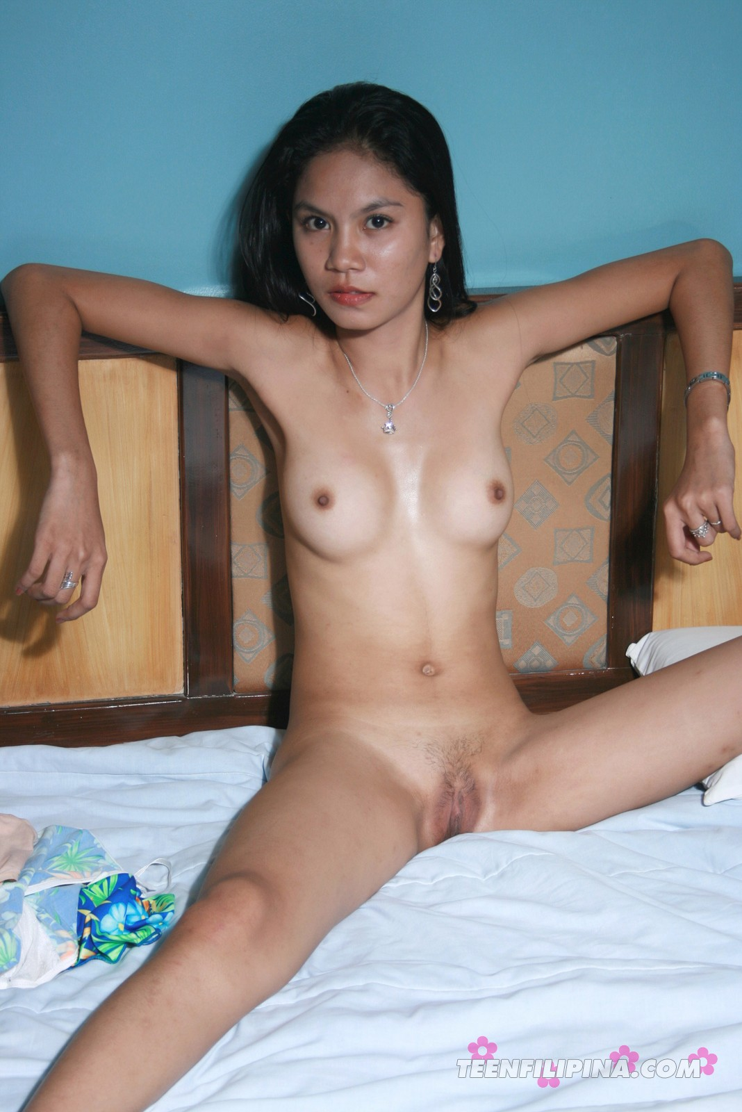 Cute skinny Filipina babe Gerry poses nude.
