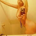 Blonde selfie teen does her best naked ducky face - image