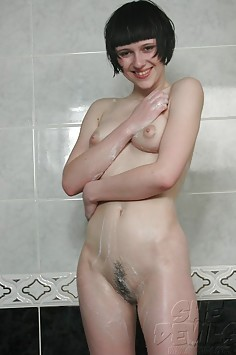 Kinky looking art school girl nude in the bath tub