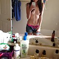 Young looking shaved teen does some sexy mirror pics - image