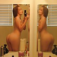 Crazy and wild looking gf gets naked in the mirror - image