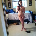 Showing her perfect nude body off in the mirror - image