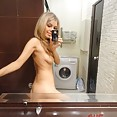 Stunning blonde girl friend does some mirror shots - image